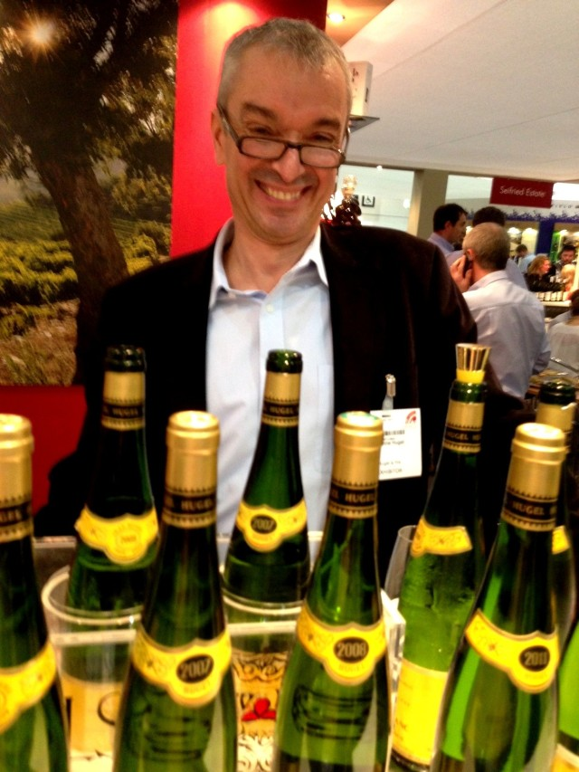 Etienne Hugel looking chuffed to be surrounded  by his wines!