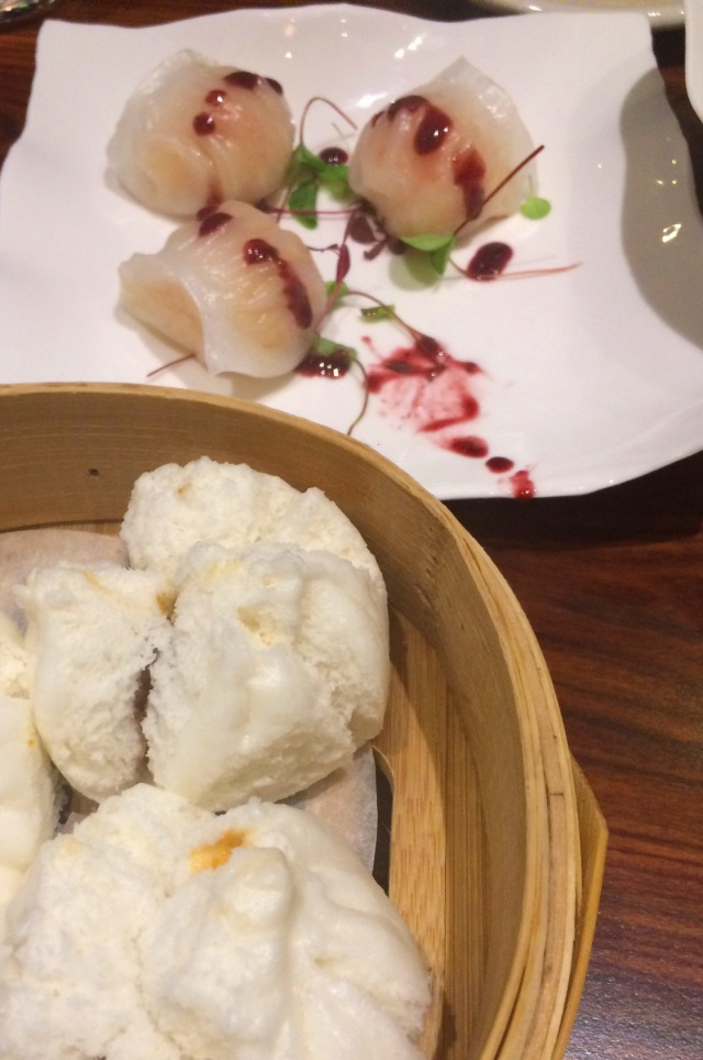 Steamed buns and dumplings with berry sauce.